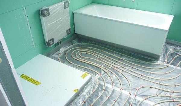 Теплый пол в стяжке ванной